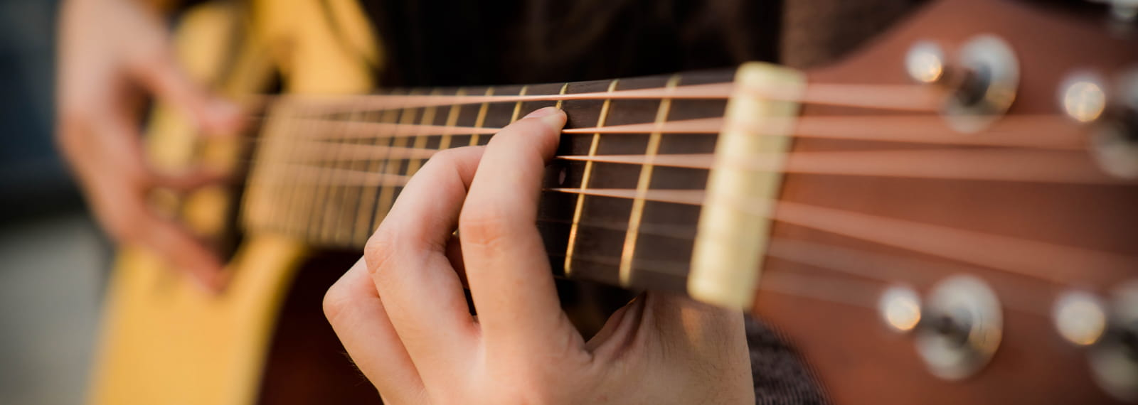 person-playing-guitar-2118045